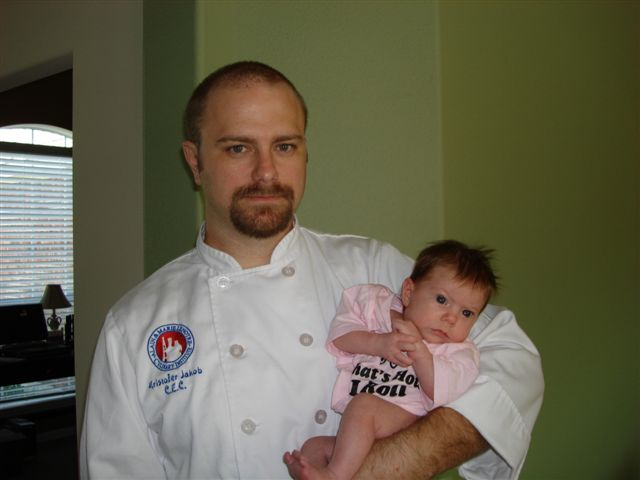 Kris Jakob and his daughter at work